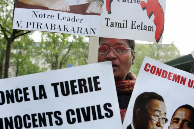 Tamils hold placards and chant slogans as they demonstrate in Paris, April 30, 2009 to call for a ceasefire in Sri Lanka and the immediate intervention of the international community. Sri Lanka's president ruled out halting the military's offensive against the Tamil Tigers, and warned the rebels that they must give up or be killed. (File/UPI Photo/Eco Clement)