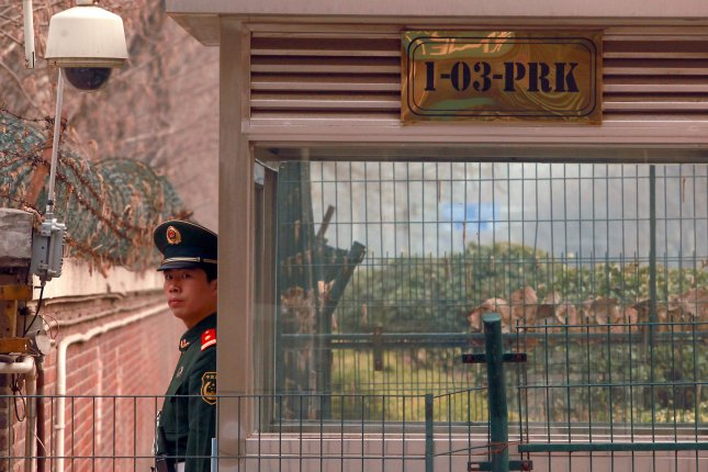 A Chinese People's Liberation Army soldier stands guard at the North Korean embassy in Beijing. North Korea is using announcements of nuclear arms development as a deterrent, a U.S. analyst said Monday. File Photo by Stephen Shaver/UPI