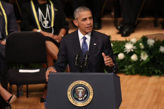 President Barack Obama delivers remarks in Dallas Tuesday afternoon at an interfaith memorial service honoring five fallen police officers who were killed during an ambush-style assault last week. During his speech, Obama called for persistence and unity among Americans in the face of continuing intolerance and racial differences. Photo By Chris McGathey/UPI