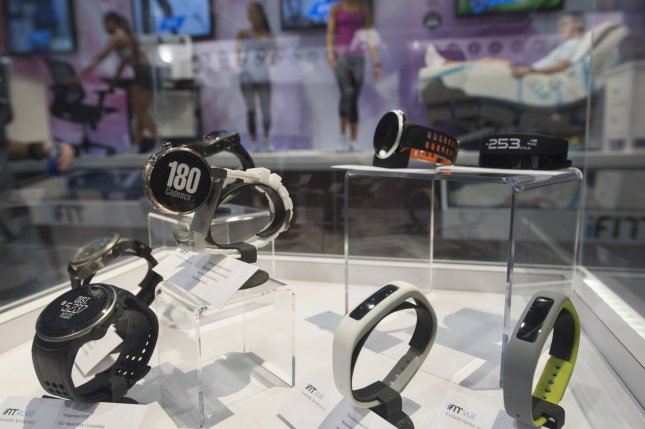 Wearable health and fitness tracking devices on display at CES. Wearable sensors may help you keep track of your health and warn you of impending illness, a new study suggests. Photo by Molly Riley/UPI