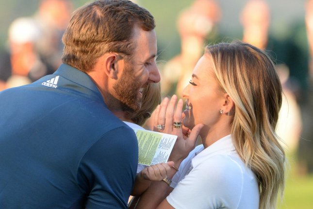 Dustin Johnson celebrates with Paulina Gretzky and son Tatum on the 18th green after making a birdie putt and winning his first major championship in the final round at the 2016 U.S. Open at Oakmont Country Club near Pittsburgh, Pa. File Photo by Pat Benic/UPI
