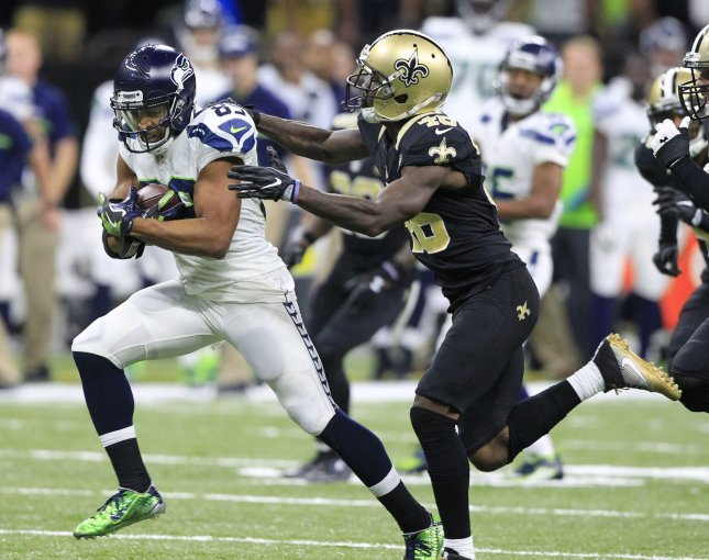 New Orleans Saints cornerback Ken Crawley attempts to make a tackle on Seattle Seahawks wide receiver Doug Baldwin in a game last season. Photo by AJ Sisco/UPI