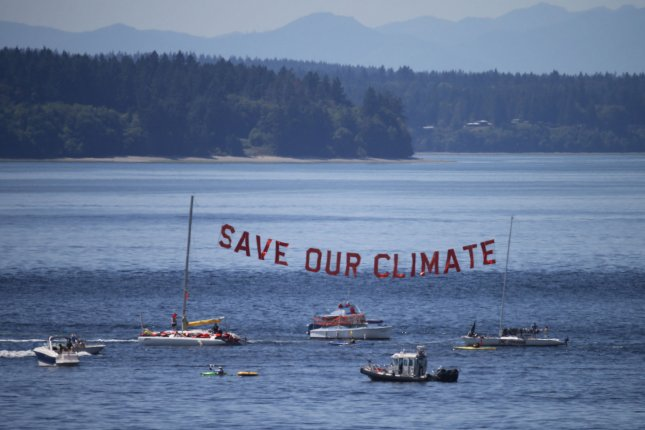 Boats deliver a message in Puget Sound, just off the golf course, during the fourth round of the 115th U.S. Open Championship at Chambers Bay on June 21, 2015, in University Place, Washington. File photo by Jim Bryant/UPI