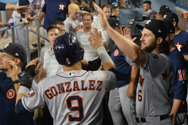 Houston Astros' Marwin Gonzalez celebrates in the dugout with teammates after hitting a solo home run off Los Angeles Dodgers' starting pitcher Kenta Maeda in the second inning on Saturday at Dodger Stadium in Los Angeles. Photo by Jim Ruymen/UPI