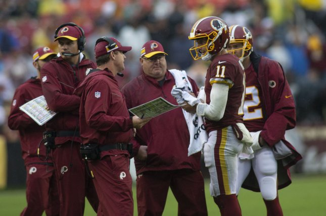 Washington Redskins quarterback Alex Smith (11) talks with Redskins head coach Jay Gruden during Week 3 of the NFL season against the Green Bay Packers on September 23, 2018 at FedEx Field in Landover, Maryland. Photo by Alex Edelman/UPI