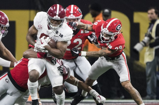 Alabama Crimson Tide running back Josh Jacobs (8) is brought down by the Georgia Bulldogs' defense after a reception in the second half of the National Championship Game on January 8, 2018 at Mercedes-Benz Stadium in Atlanta. Photo by Mark Wallheiser/UPI