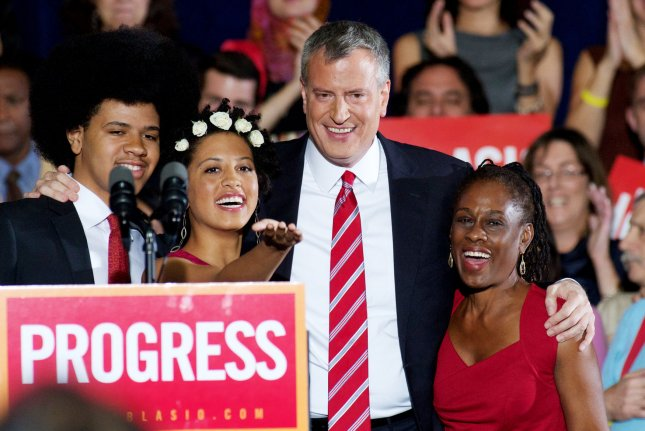 Democratic candidate Bill de Blasio embraces his children Dante and Chiara and wife Chirlane (R) after winning the mayoral election at the Park Slope Armory campaign headquarters in New York on November 5, 2013. De Blasio ran against Republican Joseph Lhota and becomes the first new mayor in twelve years, replacing Michael Bloomberg. UPI/Monika Graff