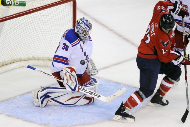 New York Rangers goalie Henrik Lundqvist (30) of Sweden makes a save on power play shot by Washington Capitals right wing Mike Knuble (22) in the 1st period at the Verizon Center in Washington on October 8, 2009. (UPI Photo/ Mark Goldman)