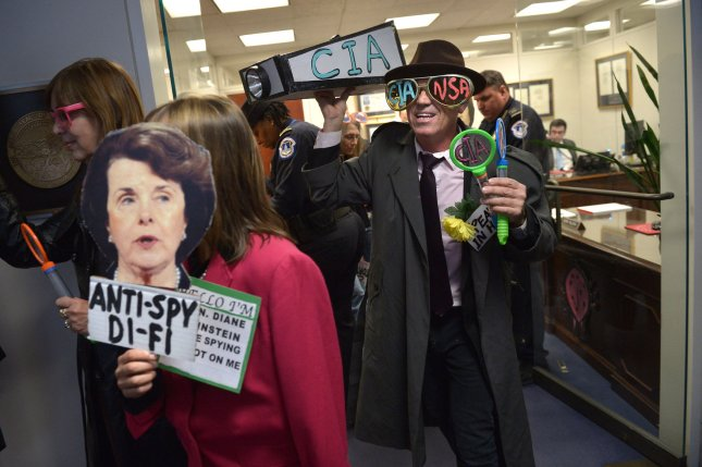 Members of the CodePink activist group demonstration against Sen. Dianne Feinstein (D-CA) and what the group is calling her 'two-faced stance on spying' inside her office in the Hart Senate Office Building in Washington, DC, on March 12, 2014. UPI/Kevin Dietsch