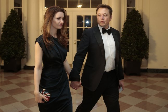 Elon Musk, co-founder and chief executive officer of Tesla Motors Inc., right, and Talulah Musk. UPI/Andrew Harrer/Pool