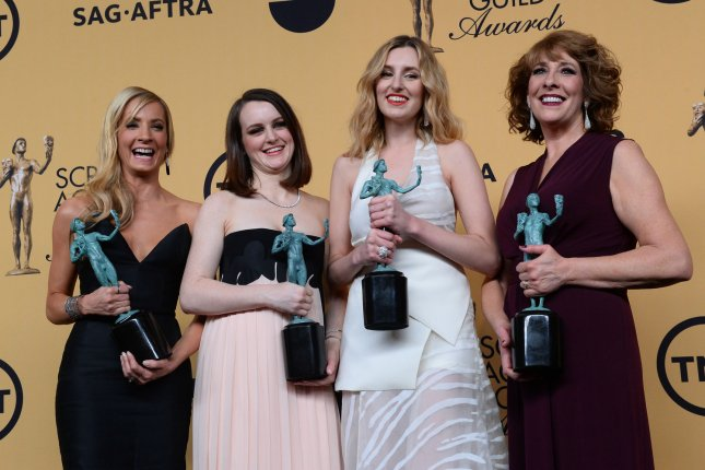 (L-R) Joanne Froggatt, Sophie McShera, Laura Carmichael and Phyllis Logan pose backstage with the award for outstanding performance by a ensemble in a drama series for Downton Abbey at the 21st annual SAG Awards held at the Shrine Auditorium in Los Angeles on Jan. 25, 2015. Photo by Jim Ruymen/UPI