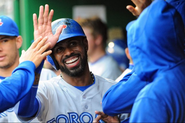 Former Toronto Blue Jays shortstop Jose Reyes (7) is congratulated in the dugout after scoring against the Washington Nationals in the first inning at Nationals Park in Washington, D.C. on June 3, 2015. Photo by Mark Goldman/UPI