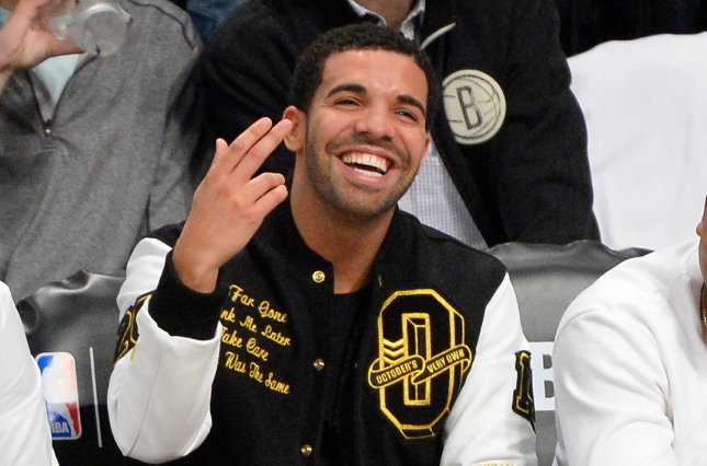 Drake reacts to the scoreboard in the second quarter of Game 6 of the Eastern Conference Quarterfinals on May 2, 2014. Drake and Travis Scott performed at a concert in the O2 arena in London Wednesday that was highlighted by Scott falling down a stage hole. File Photo by Rich Kane/UPI