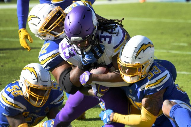 Minnesota Vikings running back Dalvin Cook (33) had 1,654 yards from scrimmage and 13 touchdowns in 14 games this season. Photo by Jon SooHoo/UPI