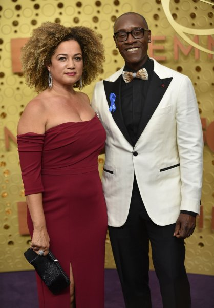 Bridgid Coulter (L) and Don Cheadle arrive for the 71st annual Primetime Emmy Awards held at the Microsoft Theater in downtown Los Angeles on September 22, 2019. Cheadle turns 56 on November 29. File Photo by Christine Chew/UPI