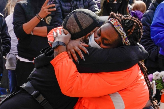 Activists embrace on April 20 at the George Floyd Memorial at the Minneapolis intersection where he was killed by a police officer. They gathered after the officer was found guilty in Floyd's death. File Photo by Jemal Countess/UPI