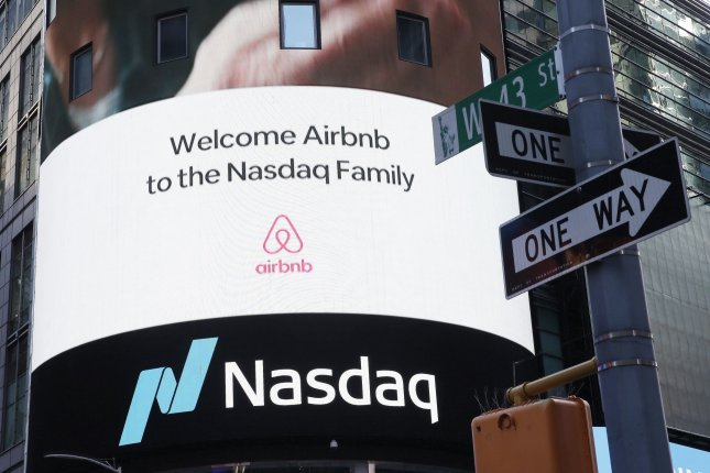 The Airbnb logo is seen outside at the Nasdaq Exchange in New York City on December 10, 2020. File Photo by John Angelillo/UPI
