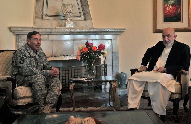 Afghan President Hamid Karzai (R) and commander of NATO forces in Afghanistan U.S. Gen. David Petraeus meet at the Presidential Palace in Kabul, Afghanistan on July 3, 2010. Petraeus arrived on July 2 to assume command of the international military mission in Afghanistan. UPI/Massoud Hossaini/Pool