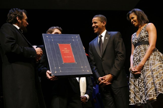 President Barack Obama receives a replica of the Gettysburg Address, a gift from the Ford's Theater in Washington on February 11, 2009. (FILE/UPI Photo/Aude Guerrucci/Pool)
