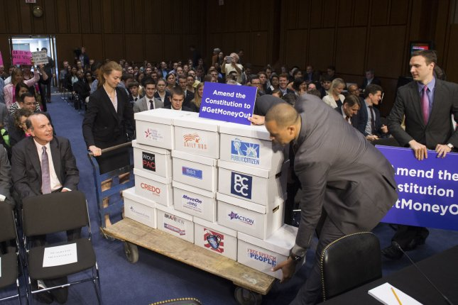Boxes containing petitions calling for a campaign finance amendment to the constitution are brought into the hearing room prior to a Senate Judiciary Committee hearing on a constitutional amendment on campaign finance, on Capitol Hill in Washington, D.C. on June 3, 2014. UPI/Kevin Dietsch