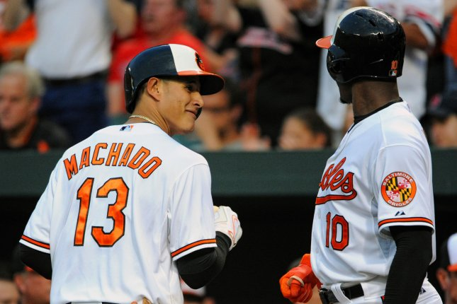 Baltimore Orioles third baseman Manny Machado (13) is congratulated by center fielder Adam Jones (10) after his solo home run against the Boston Red Sox in the fourth inning at Orioles Park at Camden Yards in Baltimore, MD. on June 11, 2015. UPI/Mark Goldman