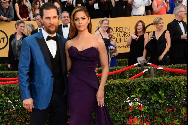 Actor Matthew McConaughey, left, and Camila Alves arrive for the 21st annual SAG Awards held at the Shrine Auditorium in Los Angeles on Jan. 25, 2015. Photo by Jim Ruymen/UPI
