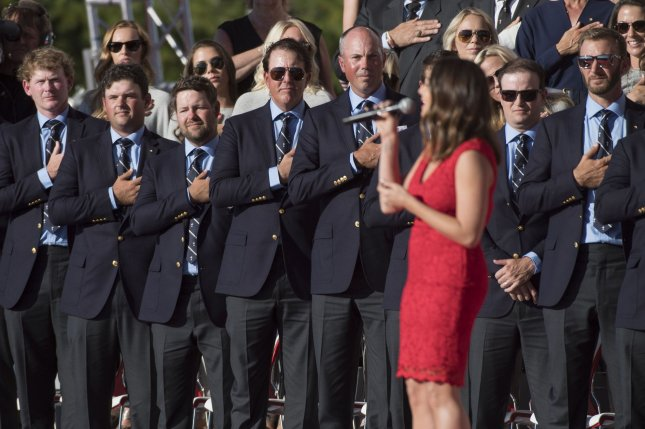 Members of Team USA stand for the national anthem during the opening ceremony of the 2016 Ryder Cup at Hazeltine National Golf Club in Chaska, Minnesota on September 29, 2016. Photo by Kevin Dietsch/UPI