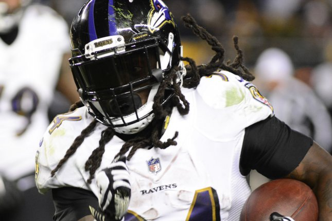 Baltimore Ravens running back Alex Collins (34) runs for the sidelines in the fourth quarter of the Pittsburgh Steelers' 39-38 win on December 10, 2017 at Heinz Field in Pittsburgh. Photo by Archie Carpenter/UPI