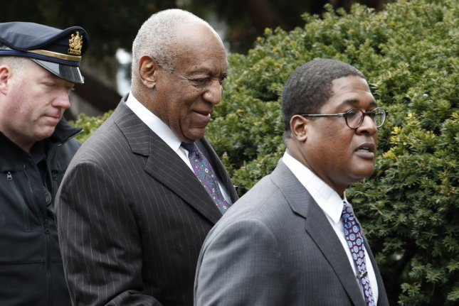 Comedian Bill Cosby (L) arrives at the Montgomery County Courthouse in Norristown, Pa., Monday for the beginning of his sexual assault retrial. Photo by Chris Szagola/UPI