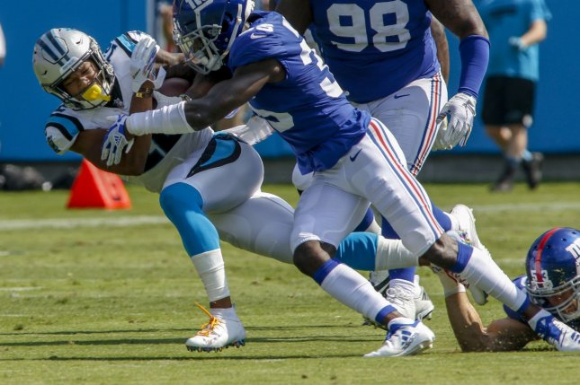bb2494865 Carolina Panthers wide receiver DJ Moore (L) is driven to the ground by New  York Giants defender Curtis Riley in the first half on October 7