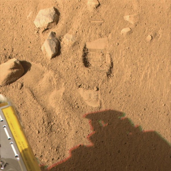 This color image, acquired by NASA's Phoenix Mars Lander's Surface Stereo Imager on Sol 7, the seventh day of the mission (June 1, 2008), shows the so-called Knave of Hearts first-dig test area to the north of the lander. The Robotic Arm's scraping blade left a small horizontal depression above where the sample was taken. (UPI Photo/NASA/JPL-Calech/University of Arizona)