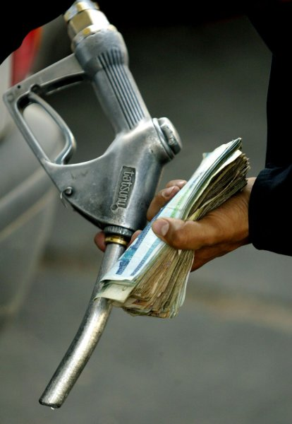 FLASHBACK: An Iranian driver fuels his car at a gas station in Tehran, Iran on May 24, 2007. Iran increased the price of gasoline by 25 percent Tuesday, trying to reduce subsidies in a decision likely to deepen dissatisfaction with the government of hard-line President Mahmoud Ahmadinejad. The price was raised to 38 cents from 30 cents a gallon. The average price in the United States at this time is approximately $3.18. (UPI Photo/Mohammad Kheirkhah)