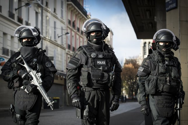 This handout picture shows French police special forces during a raid in an apartment in Saint Denis, North of Paris, during an operation aimed at capturing suspected mastermind of the Paris attacks, Belgian Abdelhamid Abaaoud. The U.S. Department of State on Monday issued a worldwide travel alert for American citizens in response to increased terrorist threats. Photo by Francis PELLIER/MI/DICOM//UPI