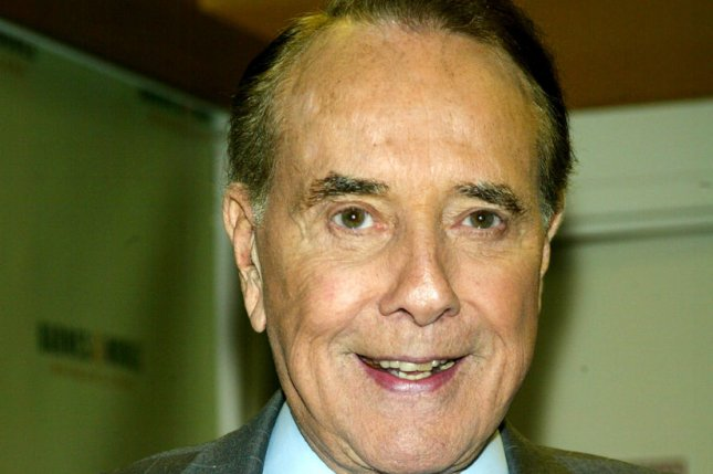 Senator Bob Dole signs copies of his book One Soldier's Story at Barnes & Noble in New York on April 13, 2005. (UPI Photo/Laura Cavanaugh)