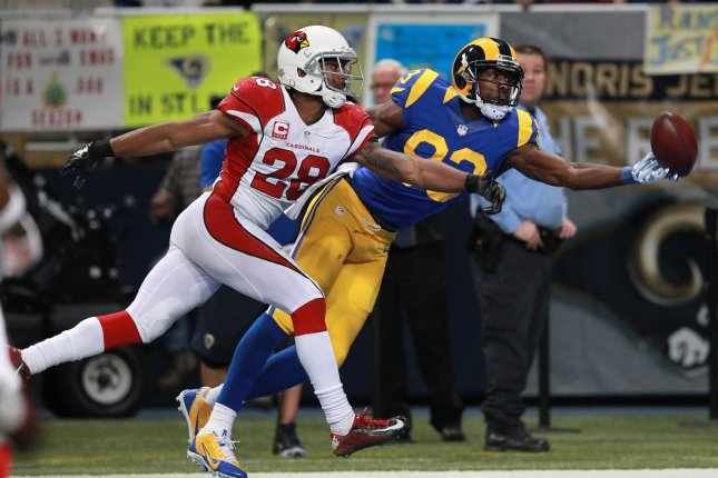 St. Louis Rams' Brian Quick can't hold onto the football passed from quaterback Nick Foles as Arizona Cardinals' Justin Bethel defends in the fourth quarter at the Edward Jones Dome in St. Louis on December 6, 2015. Arizona defeated St. Louis 27-3. Photo by Bill Greenblatt/UPI