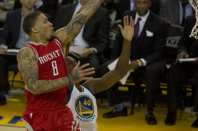 fa8d073b3da Houston Rockets forward Michael Beasley (8) puts up a shot over Golden  State Warriors  Harrison Barnes (40) in the 2016 NBA playoffs.