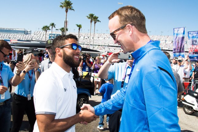 NASCAR driver Darrell Wallace Jr. (left) and former NFL quarterback Peyton Manning chat prior to the 2018 Daytona 500 on Sunday at Daytona International Speedway in Daytona, Florida. Wallace Jr. will start seventh, and Manning is the honorary pace car driver. Photo by Edwin Locke/UPI