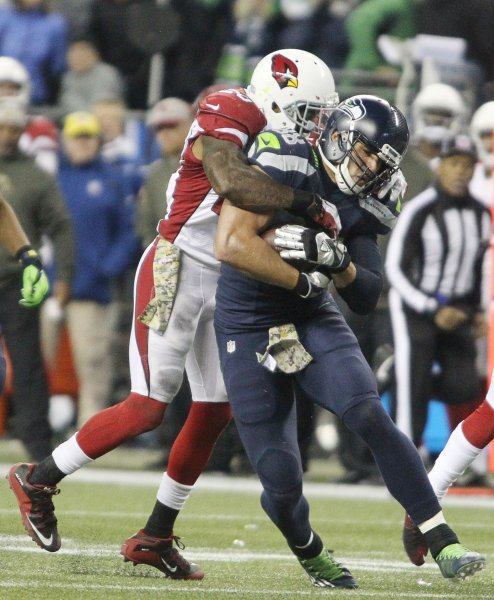 Arizona Cardinals linebacker Deone Bucannon wraps up Seattle Seahawks tight end Jimmy Graham during their game on November 15, 2015. Photo by Jim Bryant/UPI