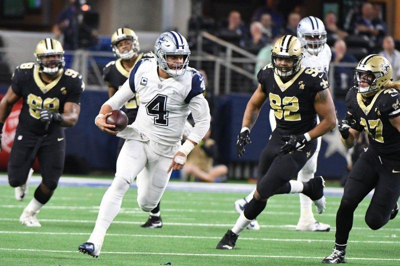 Dallas Cowboys quarterback Dak Prescott scrambles for 15 yards against the New Orleans Saints during their NFL game on Thursday at AT&T Stadium in Arlington, Texas. Photo by Ian Halperin/UPI