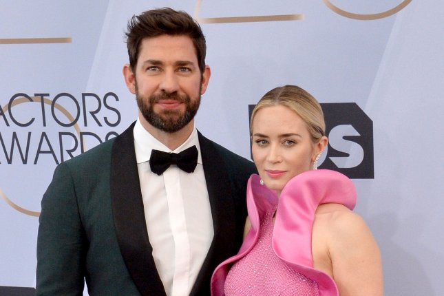 John Krasinski (L), pictured with Emily Blunt, has started production on A Quiet Place: Part II, a sequel to his horror film starring Blunt. File Photo by Jim Ruymen/UPI