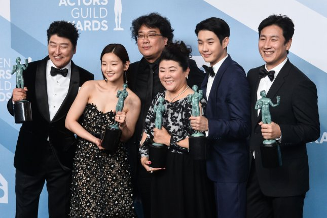 Parasite, a South Korean film directed by Bong Joon-ho (back center) that won Best Picture at the 2020 Academy Awards, is coming to Hulu in April. File Photo by Jim Ruymen/UPI