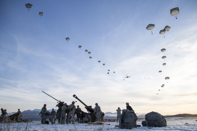 U.S. Army paratroopers descend over Malemute drop zone while conducting airborne and live fire training at Joint Base Elmendorf-Richardson, Alaska, in 2016. Photo by Alejandro Pena/U.S. Air Force