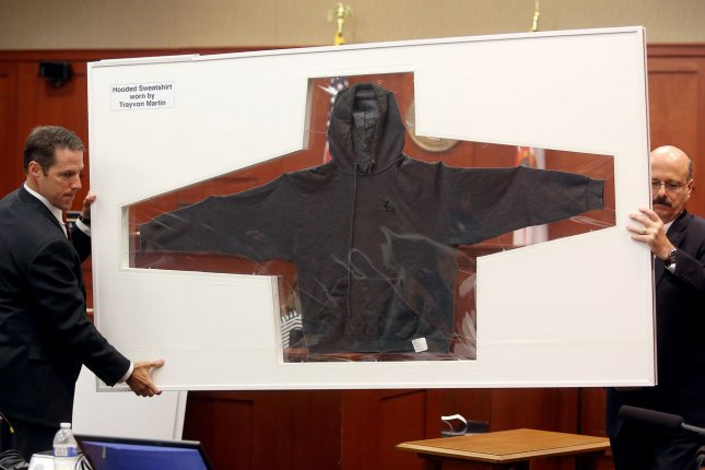 Assistant state attorney John Guy (left) and Assistant state attorney Bernie de la Rionda display the hooded sweatshirt worn by Trayvon Martin the night he was shot by George Zimmerman on day eighteen of George Zimmerman's trial in Seminole circuit court Sanford, Florida, July 3, 2013. UPI/Jacob Langston/Pool