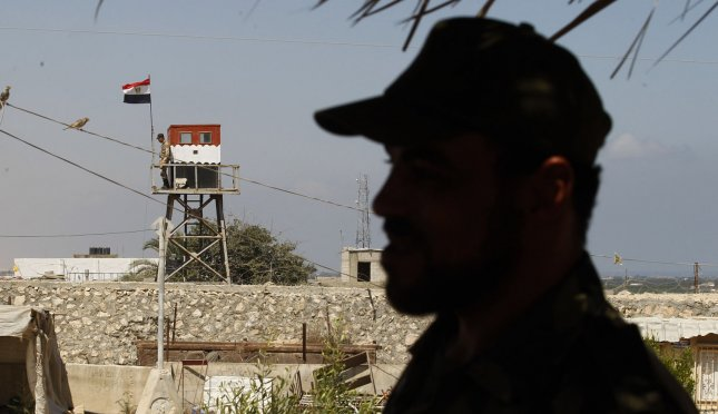 An Egyptian soldier stands on a watch tower on the border with Egypt, at the Rafah border crossing in Southern Gaza on July 5, 2013. UPI/Ismael Mohamad
