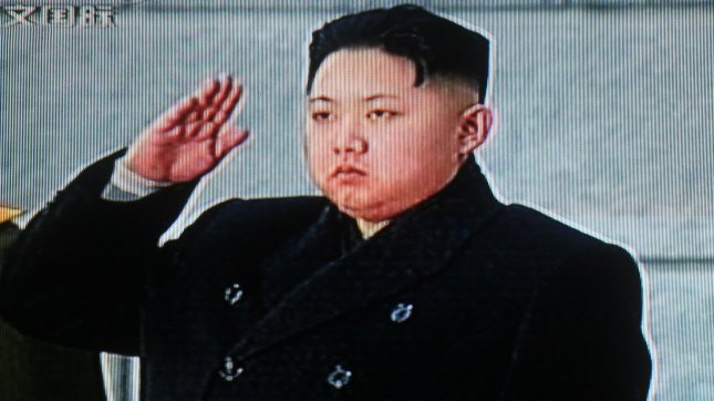 China's state television shows footage of Kim Jong-un saluting his father North Korean leader Kim Jong-Il's body during a state funeral in Pyongyang December 28, 2011. North Korean officials accused South Korean media of attacking Kim Jong-un. UPI/Stephen Shaver