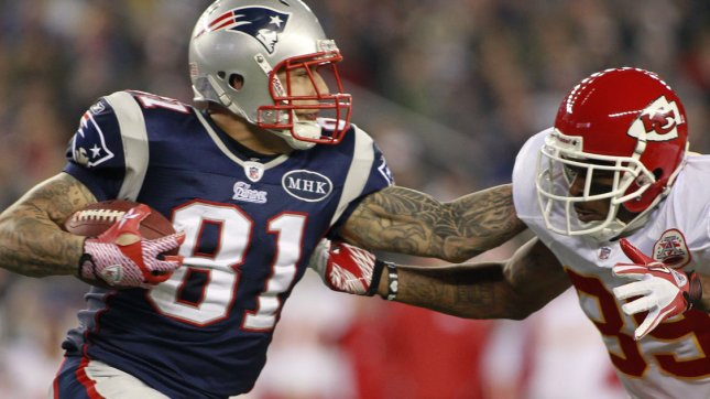 Former New England Patriots tight end Aaron Hernandez dodges a tackle by Kansas City Chiefs Aaron Carr. A secret apartment rented by Hernandez has further tied him to the murder of Odin Lloyd. UPI/Matthew Healey