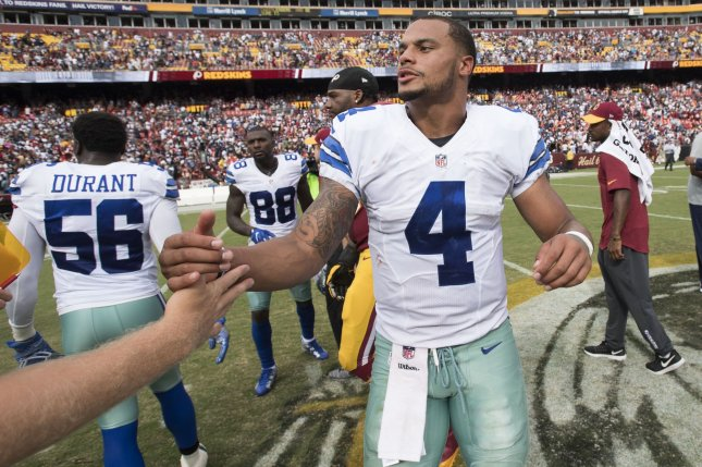 Dallas Cowboys quarterback Dak Prescott (4) is congratulated after the Cowboys defeated the Washington Redskins 27-23 at FedEx Field in Landover, Maryland on September 18, 2016. Photo by Kevin Dietsch/UPI