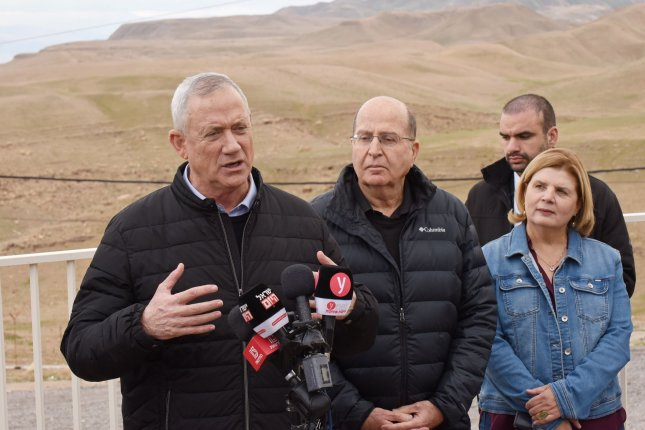 At left, Benny Gantz, chairman of the Blue and White Party, speaks to reporters in the Israeli settlement of Vered Jericho, near Jericho, in the West Bank, on Tuesday. Photo by Debbie Hill/UPI