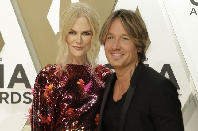 Keith Urban (R) poses with his wife Nicole Kidman. Urban will be headlining the 2020 Watershed Festival along with Thomas Rhett and Dierks Bentley. File Photo by John Angelillo/UPI