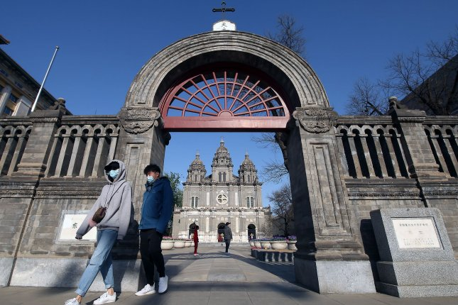 Visitors walk past the St. Joseph Catholic Church, which is closed due to the coronavirus crisis, in central Beijing, China, on Sunday. Photo by Stephen Shaver/UPI